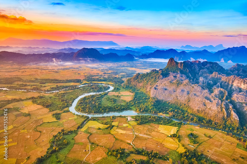 Fotobehang Oranje eclat Aerial view of the fields, river and mountain. Beautiful landscape. Laos.