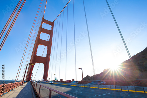 gold gated bridge in sunny sky - 187563655