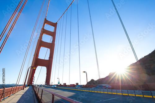 gold gated bridge in sunny sky