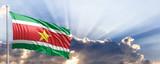 Suriname flag on blue sky. 3d illustration
