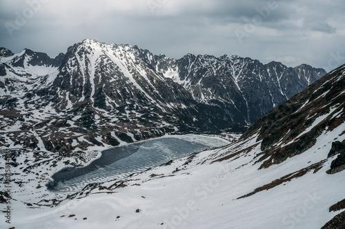 Foto Murales Winter landscape with scenic frozen lake, Morskie Oko, Sea Eye, Tatra National Park, Poland