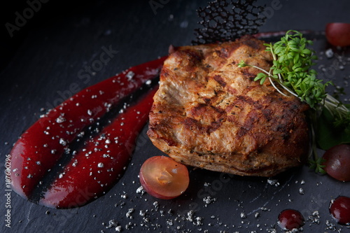 Aluminium Steakhouse Fried meat steak on a black background