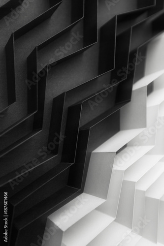 Black and white abstract background with stripes of paper