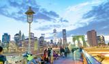NEW YORK CITY - JUNE 8, 2013: Tourists walk on Brooklyn Bridge at night. New York attracts 50 million people every year - 187606649