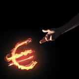 Concept of money making with euro currency fire symbol on dark b - 187609281