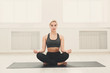 Young woman in yoga class, relax meditation pose