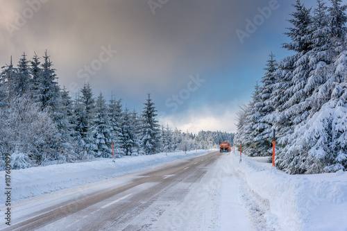Foto op Plexiglas New York TAXI Wintertime - Black Forest. Winter landscape with snowplow clearing road after snowstorm.