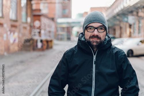 Fridge magnet Modern urban man in anorak and knitted cap
