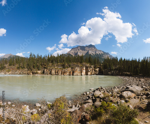 Foto Murales Scenic remote wide valley with river and forest in Rocky Mountains in Canada on sunny day