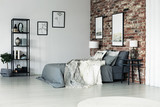 Spacious brick wall bedroom - 187620868