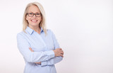 Middle aged business woman with eyeglasses in blue shirt isolated on white background - 187621272