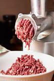 Preparation of minced meat in grinder - 187628607