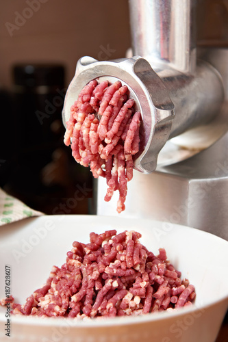Preparation of minced meat in grinder - 187628607