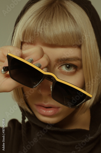 8653b2fdba86 Blonde girl with short hair style in fashion glasses