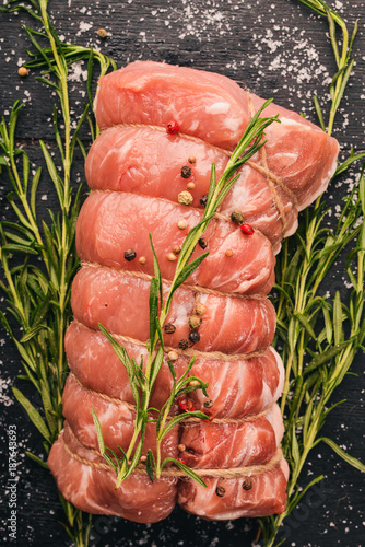 Raw meat Beef fillet with rosemary and spices on a black wooden background. Top view. Free space for text - 187643693