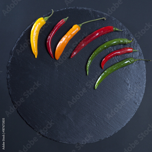 Foto op Canvas Hot chili peppers the chilli pepper on black stone