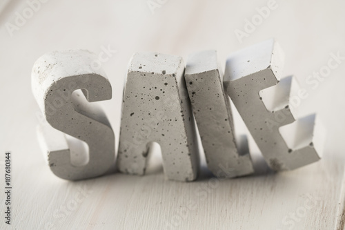 concrete letters on a wooden board - 187680844