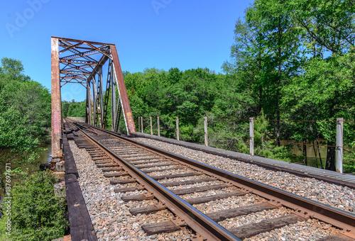 Old metal truss railroad bridge in florida - 187697671