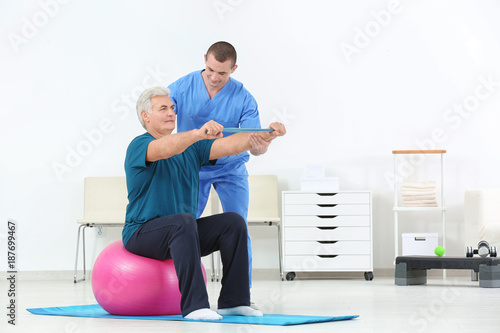 Height scale Physiotherapist working with patient in rehabilitation centre