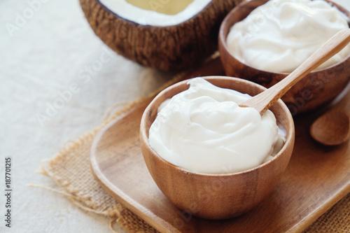 homemade organic coconut greek yogurt in wooden bowl - 187701215