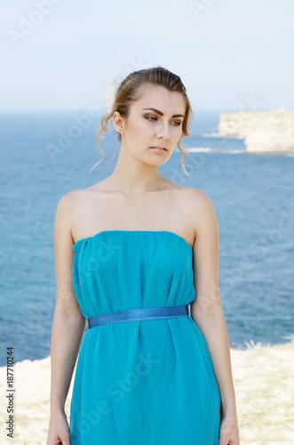 Young woman at sea shore Poster