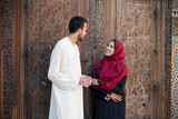 Muslim couple in relationship talking and smiling - 187724054