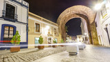 Trajano Arch at night with car light trail in Merida - 187728060