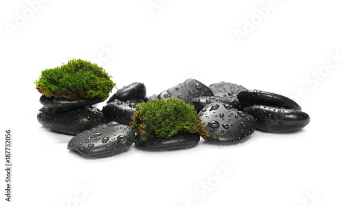 Green wet moss with black spa rocks and drops of water isolated on white background - 187732056