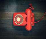 retro red phone on a old wooden floor - 187734432