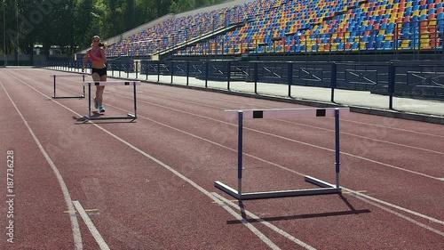 Foto op Plexiglas Motorsport Female gymnast running hurdle race, preparation for important competition