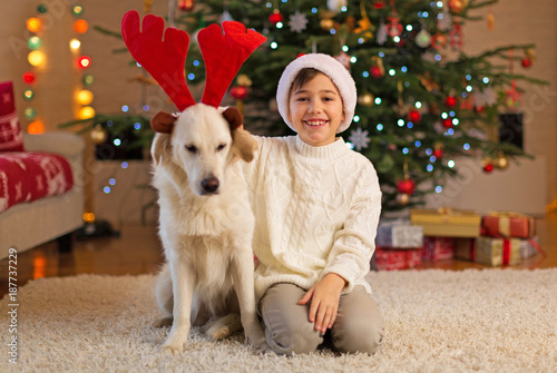 Poster Boy and dog by Christmas tree