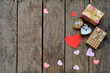 Ring and gifts on wooden board. Festive background for Birthday, Mother's day, Valentine's Day, March 8, Wedding concept greeting card. Copy space for text.