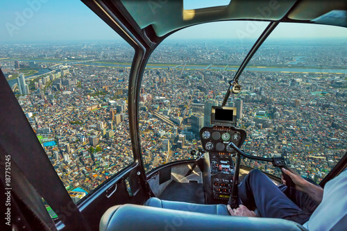 Fotobehang Tokio Helicopter cockpit inside the cabin flying on Tokyo cityscape. Sumida District, Japan. Sunny day.