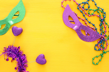 Top view image of masquerade background. Flat lay. Mardi Gras celebration concept.