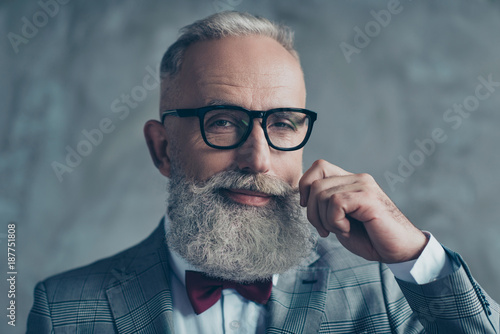 Leinwandbild Motiv Close up portrait of grinning old-fashioned trendy elegant wealthy professional flirty trendsetter hipster grandpa sharp dressed with maroon bow-tie twisting white mustache isolated on grey background