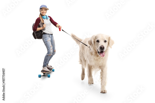 Female skater with a backpack riding a longboard and walking a dog Poster
