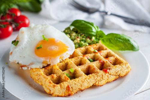 Fresh baked sweet potato waffles with ..scrambled eggs and avocado dip. Healthy breakfast - 187761240