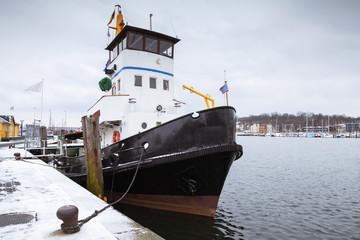 Vintage tug boat moored in port of Flensburg