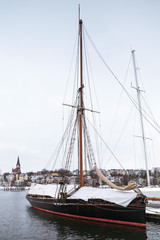 Sailing yachts moored in marina in winter