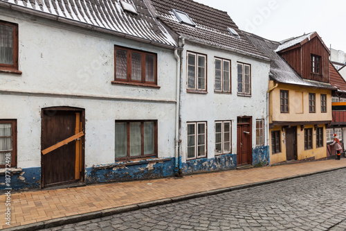 Houses stand in a row in Flensburg, Germany - 187772498