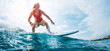 Young surfer rides the ocean wave