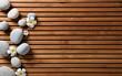 zen pebbles and spa flowers set on hammam wooden board - 187778621