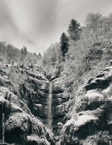 Waterfall on snowy mountain - 187795461
