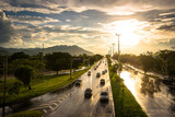 Rainy Wet Highway With Vehicles Driving by Sunset
