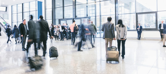 business commuters walking at a airport