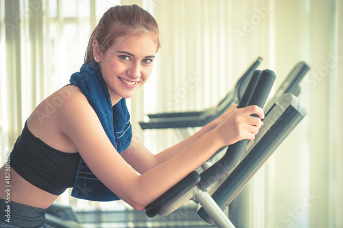 Fridge magnet Woman working out in fitness gym is smiling to the camera
