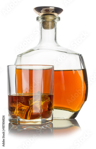 glass with cognac and ice, next bottle with cognac
