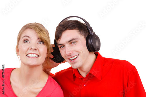 Couple two friends with headphones listening to music - 187808061