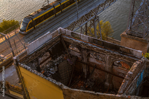 Fotobehang Oude verlaten gebouwen Abandoned ruins buildings near the Dom Luis I bridge over the Douro river of Porto, Portugal.