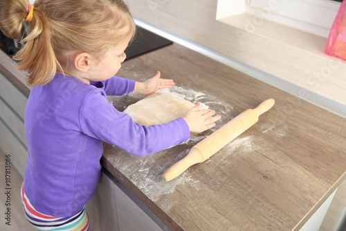 Poster Child with dough on kitchen